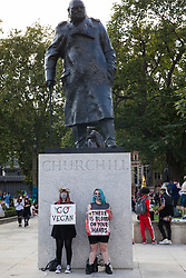 Animal rights activists from Animal Rebellion hold signs in front of the statue of Sir Winston Churchill during a Back The Bill rally by Extinction Rebellion in Parliament Square on 1st September 2020 in London, United Kingdom. Animal Rebellion activists are protesting in solidarity with victims of the global food system and to demand that the UK transitions to a sustainable plant-based food system.