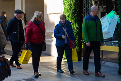 Two women make their way along Oxford Street withy shopping bags as high street retailers are facing their quietest Christmas since the credit crunch. London, December 13 2018.