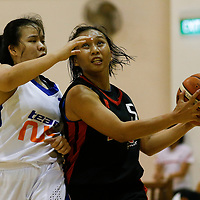 Shermaine See (#5) of Nanyang Technological University drives against (#12) of National University of Singapore. (Photo © Lim Yong Teck/Red Sports)