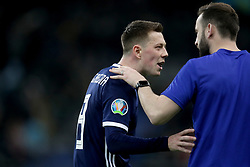 Scotland's Callum McGregor (left) exchanges words with assistant coach James McFadden after the UEFA Euro 2020 Qualifying, Group I match at the Astana Arena.