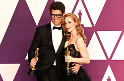 Guy Nattiv (left) and Jaime Ray Newman with the award for Short Film (live action) for Skin in the press room at the 91st Academy Awards held at the Dolby Theatre in Hollywood, Los Angeles, USA