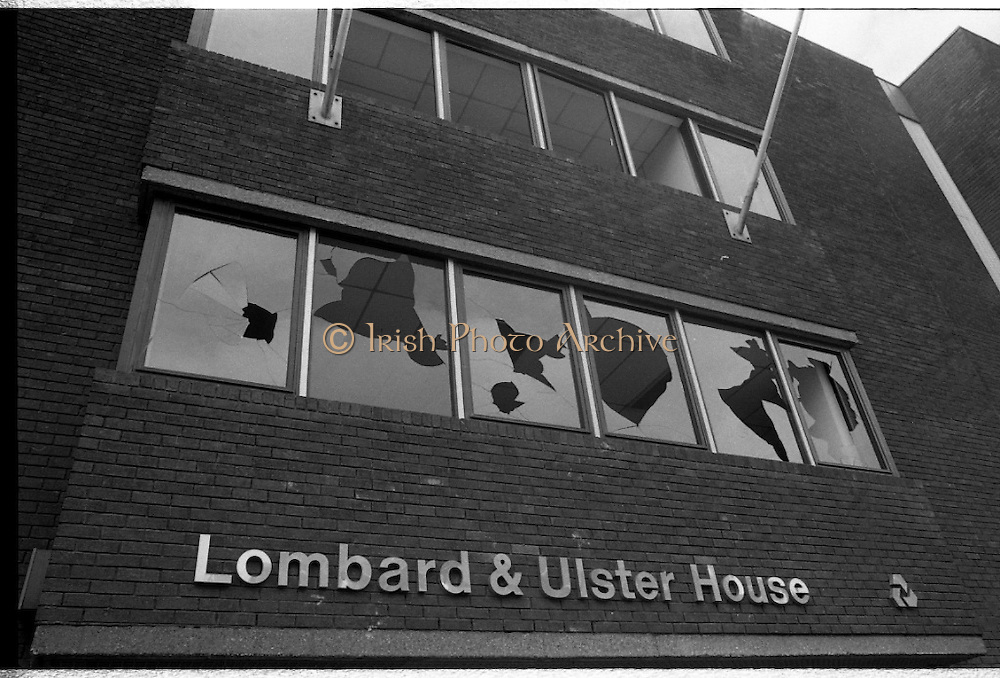 H-Block Protest To British Embassy.  (N86)..1981..18.07.1981..07.18.1981..18th July 1981..A protest march to demonstrate against the H-Blocks in Northern Ireland was held today in Dublin. After the death of several hunger strikers in the H-Blocks feelings were running very high. The protest march was to proceed to the British Embassy in Ballsbridge...The first floor of the Lombard and Ulster building shows the scars of the riot which followed the H-Block protest in Ballsbridge.