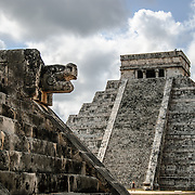 Temple of Kukulkan (El Castillo) at Chichen Itza Archeological Zone, ruins of a major Maya civilization city in the heart of Mexico's Yucatan Peninsula. At left, the building is known as the Venus Platform.