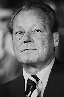 ca. September 1976, Dortmund, West Germany --- Willy Brandt, Chairman of the Social Democratic Party (SPD) and former chancellor, listens at a SPD rally during the 1976 chancellor election. Incumbent Chancellor Helmut Schmidt of the SPD would prevail over Helmut Kohl during this election. --- Image by © Owen Franken/CORBIS