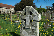 Cross motif gravestone in the graveyard of St. Marys Church, Brighstone, is a parish church in the Church of England on the Isle of Wight, UK.