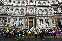 © Licensed to London News Pictures. 16/10/2019. London, UK. Extinction Rebellion march with a large white puppet horse to protest against climate change at the Japanese Embassy in central London. Activists continue to occupy roads around Westminster for the 10th day as protesters gather in Trafalgar Square to oppose the Police ban. Photo credit: Alex Lentati/LNP