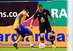 Shaun Maloney of Hull City takes on Mitchell Rose of Mansfield - Mandatory by-line: Matt McNulty/JMP - 19/07/2016 - FOOTBALL - One Call Stadium - Mansfield, England - Mansfield Town v Hull City - Pre-season friendly