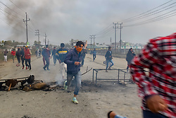 November 1, 2018 - Pulwama, Jammu & Kashmir, India - Kashmiri Protesters are seen running for cover as they are being chased by the Indian forces during the clashes..Officials say two rebels were killed in a gun battle with Indian government forces, Clashes erupted in Pampore area of Pulwama some 20kms from summer capital of Srinagar after the news spread throughout the area. (Credit Image: © SOPA Images via ZUMA Wire)