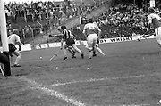 18/07/1976<br /> 07/18/1976<br /> 18 July 1976<br /> Leinster Hurling Final: Kilkenny v Wexford at Croke Park, Dublin. <br /> This picture shows a Wexford attack on the Kilkenny goal. Noel Skehan (1), Kilkenny goalkeeper, gets ready to try to stop the ball with the aid of the Kilkenny captain, Phil Larkin (2). <br />Christy Kehoe (15), Wexford forward, goes to the assistance of his teammate, Mick Butler (wearing a helmet).
