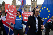 BBC reporter Chris Mason amidst anti Brexit pro Europe demonstrators waving European Union and Union Jack flags and placards in Westminster opposite Parliament on the as five days of Brexit debate begins on 4th December 2018 in London, England, United Kingdom.