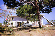 Morris Minor car parked outside coastal home, Balandra, Trinidad early 1960s