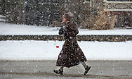 Joseph Maria, a Francisan Brother Minor and a student at Holy Cross College, jogs in his robes on Taylor Street in South Bend. Maria  can often be seen jogging the South Bend streets and sidewalks.