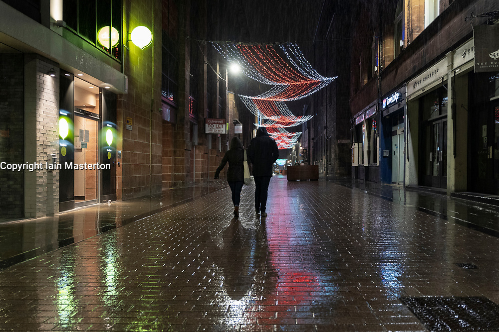 Edinburgh, Scotland, UK. 19 December 2020.  Views of streets and shops in Edinburgh City Centre on evening that Scottish Government announced the highest level 4 lockdown will be enforced from Boxing Day in Scotland.  Pic; Normally busy with nightlife, Rose Street pubs are closed and street deserted. Iain Masterton/Alamy Live News
