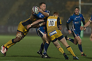 Jack Dixon of the Newport Gwent Dragons tries to release the ball in the tackle as Connor Braid (r) and Christian Scotland-Williamson of the Worcester Warriors tackle him hard. EPCR Challenge cup rugby match, pool 3, Worcester Warriors v Newport Gwent Dragons at the Sixways Stadium in Worcester, England on Saturday 10th December 2016.<br /> pic by  Simon Latham, Andrew Orchard sports photography.