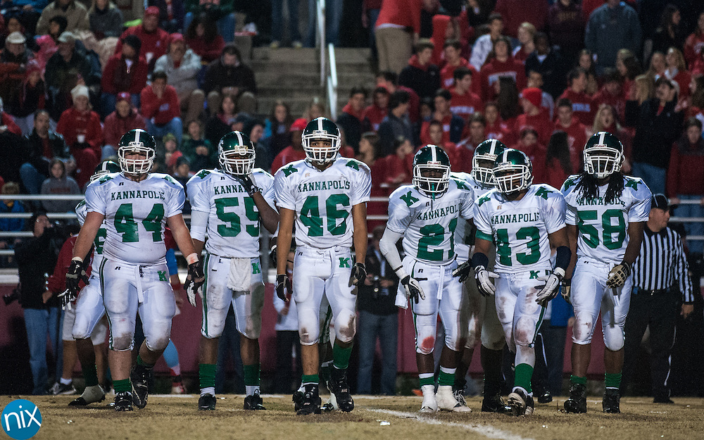 The Kannapolis defense walks off the field after Charlotte Catholic scored during the third round of the NCHSAA playoffs Friday night in Charlotte. Catholic won the game 49-18. (photo by James Nix)