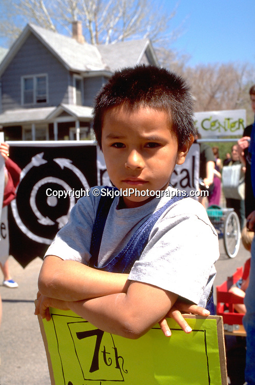Boy age 6 marching in community parade. In the Heart of the Beast May Day Festival and Parade St Paul  Minnesota USA