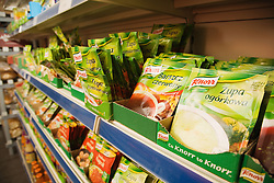 Packet soups stacked on shelf in Polish food shop,