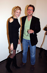 MISS FIONA SCARRY and MR WILLIAM TURNER at an exhibition of photographs by Matthew Mellon entitled Famous Feet - featuring well known people wearing shoes from Harrys of London, held at Hamiltons Gallery, Carlos Place, London on 22nd November 2004.<br /><br />NON EXCLUSIVE - WORLD RIGHTS