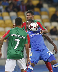 August 24, 2017 - Dieumerci Mbokani () of Dynamo vies for the ball with  Ibson Pereira de Melo   (L) and  Bebeto (R) of Maritimo  during the Europa League second play-off soccer match between FC Dynamo Kyiv and FC Maritimo, at the Olimpiyskyi stadium in Kyiv, Ukraine, August 24, 2017. (Credit Image: © Anatolii Stepanov via ZUMA Wire)