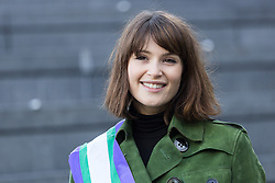 "© Licensed to London News Pictures. 08/03/2015. London, UK. Gemma Arterton at the ""Walk In Her Shoes"" event to mark International Women's Day at The Scoop amphitheatre on the south bank in London. Photo credit : Vickie Flores/LNP"
