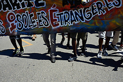 July 4, 2017 - Toulouse, France - A banner for refugees in Toulose, France, on 4 July 2017. People took to the streets of Toulouse to protest against the French policy on foreigners, refugees and unaccompanied foreign minors. They protest specifically against the Haute-Garonne departemental council. They say that, too often, unaccompanied foreign minors are considered as majors and then, can be expulsed. (Credit Image: © Alain Pitton/NurPhoto via ZUMA Press)