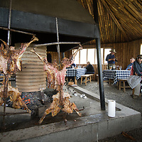 Tourists enjoy an asado barbeque near Torres del  Paine National Park in Patagonia, Chile.