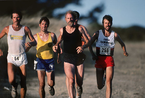 """MARIN COUNTY, CA -  JULY 1983:  Bruce Dern (in black), Garry Bjorklund #225, and other runners compete in the Cielo-Sea race during the making of the movie """"On the Edge"""" filmed in July 1983 in Marin County, California. (Photo by David Madison/Getty Images) *** Local Caption *** Bruce Dern;Garry Bjorklund"""