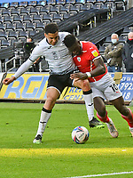 Football - 2020 / 2021 Sky Bet Championship - Play-offs - Semi-final, second leg - Swansea City vs Barnsley - Liberty Stadium.<br /> <br /> Ben Cabango Swansea City attacks Daryl Dike Barnsley defends  in the final minutes in a sunlit corner of the ground<br /> COLORSPORT/WINSTON BYNORTH