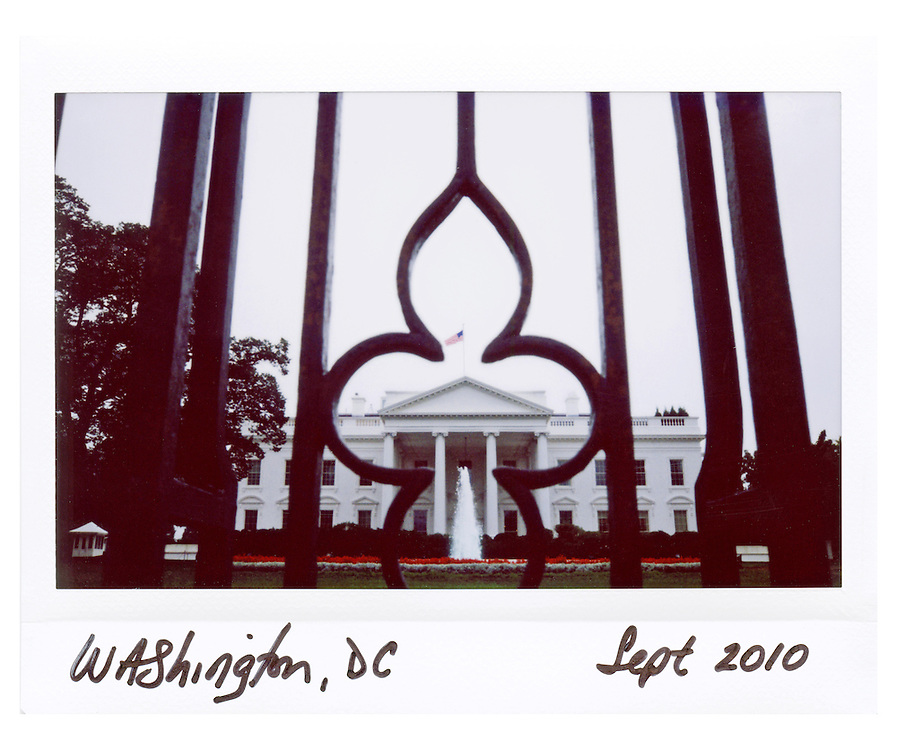 The White House is seen through the fence in Washington, September 3, 2010.
