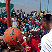 Dwight Howard played basketball at a school in central Haiti during his recent trip to the island to promote the Dwight Howard Fund.  Mandatory Credit: Alex Menendez Dwight Howard in Haiti after the 2010 earthquake for the D12 Foundation relief fund.
