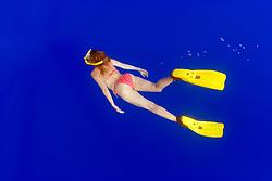 woman snorkeler in deep blue water, offshore, Kona, Big Island, Hawaii, Pacific Ocean, MR