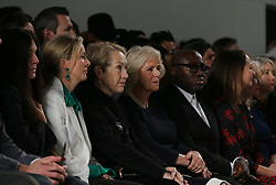 (right to left) Chief Executive of the British Fashion Council Caroline Rush, British Vogue editor Edward Enninful, and the Duchess of Cornwall watch models on the catwalk during the Bethany Williams Autumn/Winter 2019 London Fashion Week show at the BFC Show Space, London.