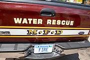 Fire department water rescue truck with designer fire license plate. Aquatennial Beach Bash Minneapolis Minnesota USA