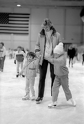 An unidentified woman guides two young girls around the ice rink at Mennen Arena in Morris Plains, N.J., Thursday, Feb. 13, 1986. (D. Ross Cameron/North Jersey Advance)