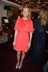 MARTHA WARD at a party hosted by Lady Kinvara Balfour, Lavinia Brennan and Lady Natasha Rufus Isaacs to celebrate the Beulah French Sole Collaboration in aid of the UN Blue Heart Campaign, held at George, 87-88 Mount Street, London on 10th December 2013.