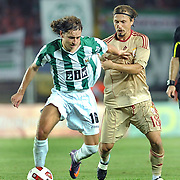 Galatasaray's Ayhan AKMAN (R) and Karpaty's Igor KHUDOBYAK (L) during their UEFA Europa League Play-Offs First Leg soccer match Galatasaray between Karpaty at AliSamiYen stadium at Istanbul in Turkey on Thursday, August 19 2010. Photo by TURKPIX