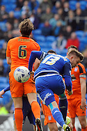 Ipswich's Christophe Berra (6) challenges Cardiff City's Anthony Pilkington (13). Skybet football league championship match, Cardiff city v Ipswich Town at the Cardiff city stadium in Cardiff, South Wales on Saturday 12th March 2016.<br /> pic by Carl Robertson, Andrew Orchard sports photography.