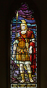 Stained glass window church of Saint Mary, Martlesham, Suffolk, England, UK - by Heaton, Butler and Bayne early 1900s, Roman soldier 'Truly this was the son of God'