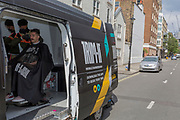 At the beginning of another week of Coronavirus pandemic lockdown, when the government is considering its options for a gradual opening of business with social distancing, a male customer sits in the chair of the app-based mobile barbershop, Trim-It, for clients needing a bespoke hair cutting service delivered to their London doorsteps, on 4th May 2020, in Pimlico, London, England.