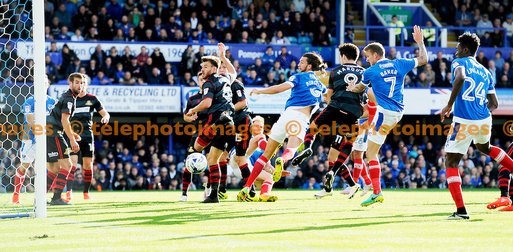 Christian Burgess of Portsmouth goes close with a header during the Sky Bet League 2 match between Portsmouth and Doncaster Rovers at Fratton Park in Portsmouth. October 1, 2016.<br /> Simon  Dack / Telephoto Images<br /> +44 7967 642437