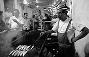 On the passage of the 12th to the 13th of June, the streets of each old Lisbon neighbourhoods gets crowded with people partying. The smell of grilled sardines fills the air as people celebrate Saint Anthony's day, Lisbon's patron saint.