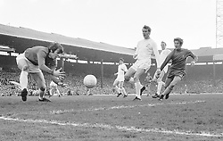 Leeds United goalkeeper David Harvey (l) gathers the ball, watched by teammates Jack Charlton (second r), Paul Madeley (third r) and Norman Hunter (fourth r), and Chelsea's John Hollins (r)