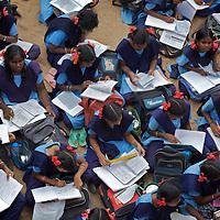 Staff and pupils at the Government Girls High School, Venugopalapuram, Cuddalore...Photo: Tom Pietrasik.Cuddalore town, Tamil Nadu. India.October 5th 2009