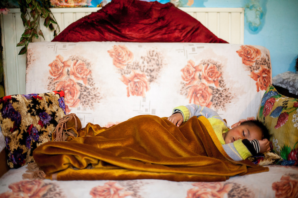 Little boy sleeping in the house of the Ibraimovska family during a door to door activity with Romina in Delcevo. They visit families, deliver brochures and putting up posters in the community to inform about health related issues and patients rights.