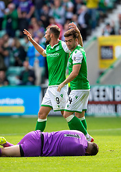 Hibernian's Christian Doidge (9) celebrates after scoring their first goal, as Hibernian's Stevie Mallan looks at the injured keeper. Hibernian 2 v 0 Alloa Athletic, Betfred Cup game played Saturday 20th July at Easter Road, Edinburgh.