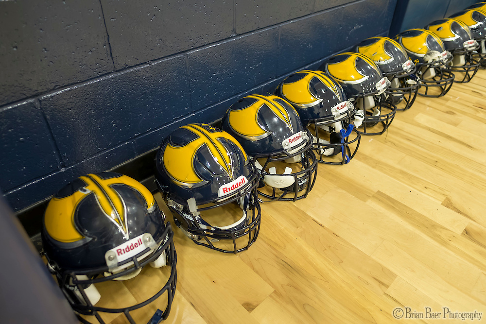 Helmets line the wall of the gym as the Oak Ridge Trojans warm up inside the gym out of the rain before the game as the Oak Ridge High School Trojans host the Granite Bay Grizzlies, Friday Oct 14, 2016.<br /> photo by Brian Baer