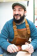 A leather artist at St. George's Market, Belfast, Northern Ireland