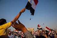 People cheering the arrival of military helicopters over Cairo's Tahrir Square, after the military arrested President Morsi.