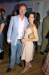 GARY & LAUREN KEMP at a party to celebrate the publication of 'How to Party' by Yasmin Mills with illustrations by Olympia Scarry, held at the Fifth Floor Restaurant, Harvey Nichols, Knightsbridge, London on 3rd July 2006.<br />