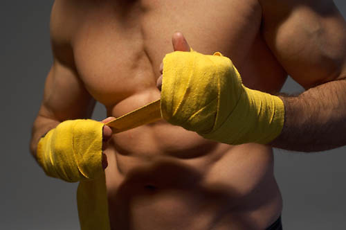 male muscular body torso, binding hands for boxing<br />